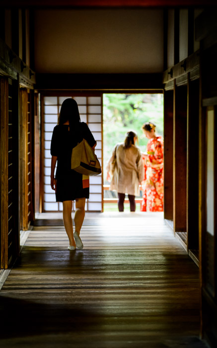 desktop background image of someone walking down the hall in the Shoren-in Temple (青蓮院), Kyoto Japan  --  Shoren'in Temple (青蓮院)  --  Copyright 2012 Jeffrey Friedl, http://regex.info/blog/