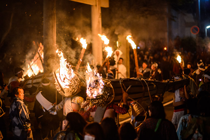 "Big Torches Being Brought In burning only small ""pilot light"" fires -- Kurama Fire Festival (鞍馬の火祭り) -- Kyoto, Japan -- Copyright 2012 Jeffrey Friedl, http://regex.info/blog/ -- This photo is licensed to the public under the Creative Commons Attribution-NonCommercial 3.0 Unported License http://creativecommons.org/licenses/by-nc/3.0/ (non-commercial use is freely allowed if proper attribution is given, including a link back to this page on http://regex.info/ when used online)"