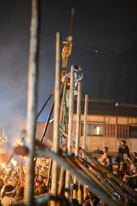 Some Guy Doing Something he was way up there attending to something on top of a pole -- Kurama Fire Festival (鞍馬の火祭り) -- Kyoto, Japan -- Copyright 2012 Jeffrey Friedl, http://regex.info/blog/ -- This photo is licensed to the public under the Creative Commons Attribution-NonCommercial 3.0 Unported License http://creativecommons.org/licenses/by-nc/3.0/ (non-commercial use is freely allowed if proper attribution is given, including a link back to this page on http://regex.info/ when used online)