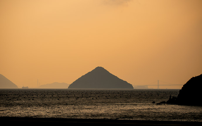 desktop background image of Oozuchi Island (in the Sedo Inland Sea, Japan) 大槌島  --  Final View from the rear of the ferry as we headed home  --  Port Miraura (宮浦港)  --  Naoshima, Kagawa, Japan  --  Copyright 2012 Jeffrey Friedl, http://regex.info/blog/