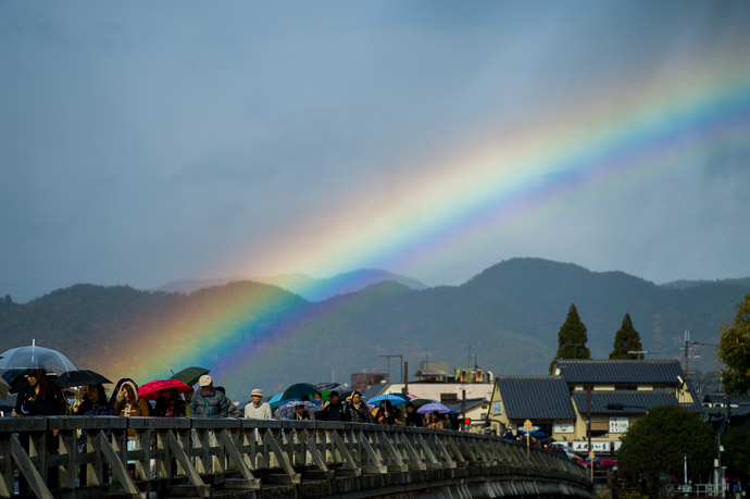 "Rainbow Over the ""Moon Crossing Bridge"" Arashiyama area of Kyoto, Japan 京都市嵐山の渡月橋と虹  --  Arashiyama (嵐山)  --  Copyright 2012 Jeffrey Friedl, http://regex.info/blog/  --  This photo is licensed to the public under the Creative Commons Attribution-NonCommercial 3.0 Unported License http://creativecommons.org/licenses/by-nc/3.0/ (non-commercial use is freely allowed if proper attribution is given, including a link back to this page on http://regex.info/ when used online)"