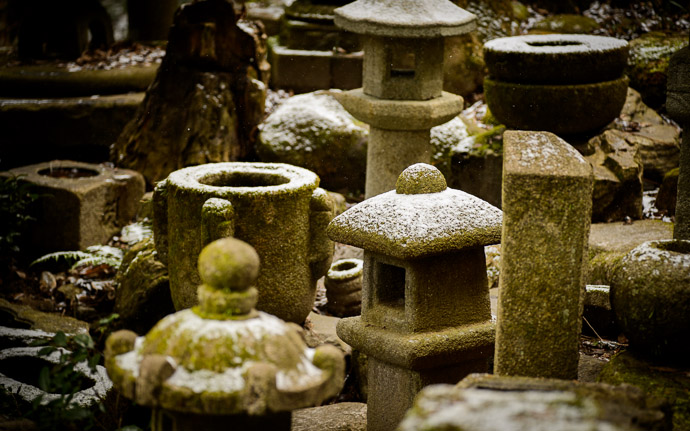 desktop background image of stone lanterns covered with a light dusting of snow, at Nishimura Stone Lanterns (), Kyoto Japan  --  Light Dusting at Nishimura Stone Lanterns (), Kyoto Japan  --  Nishimura Stone Lanterns ()  --  Copyright 2013 Jeffrey Friedl, http://regex.info/blog/  --  This photo is licensed to the public under the Creative Commons Attribution-NonCommercial 3.0 Unported License http://creativecommons.org/licenses/by-nc/3.0/ (non-commercial use is freely allowed if proper attribution is given, including a link back to this page on http://regex.info/ when used online)