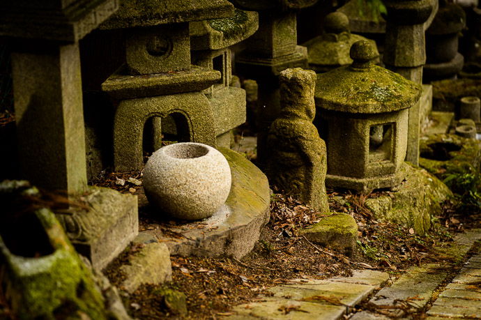 New the small basin, still free from moss, was obviously newly carved  --  Nishimura Stone Lanterns (西村石灯籠)  --  Kyoto, Japan  --  Copyright 2013 Jeffrey Friedl, http://regex.info/blog/  --  This photo is licensed to the public under the Creative Commons Attribution-NonCommercial 3.0 Unported License http://creativecommons.org/licenses/by-nc/3.0/ (non-commercial use is freely allowed if proper attribution is given, including a link back to this page on http://regex.info/ when used online)