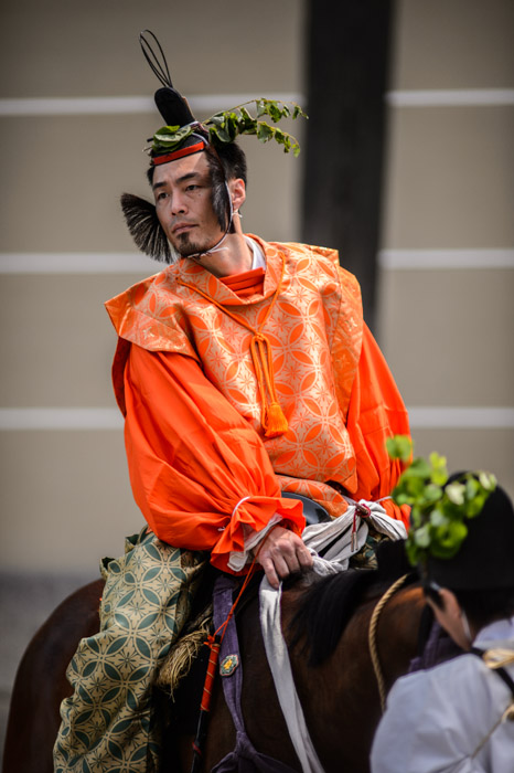 Again he was in front of me for 20 minutes, and I loved his look -- Aoi Matsuri, at the Kyoto Imperial Palace Park ( Kyoto Gosho ) (葵祭、京都御所) -- Kyoto, Japan -- Copyright 2013 Jeffrey Friedl, http://regex.info/blog/ -- This photo is licensed to the public under the Creative Commons Attribution-NonCommercial 3.0 Unported License http://creativecommons.org/licenses/by-nc/3.0/ (non-commercial use is freely allowed if proper attribution is given, including a link back to this page on http://regex.info/ when used online)