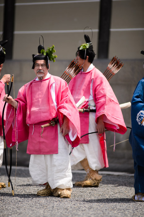 Archer eyeing me like a target -- Aoi Matsuri, at the Kyoto Imperial Palace Park ( Kyoto Gosho )  -- Kyoto, Japan -- Copyright 2013 Jeffrey Friedl, http://regex.info/blog/ -- This photo is licensed to the public under the Creative Commons Attribution-NonCommercial 3.0 Unported License http://creativecommons.org/licenses/by-nc/3.0/ (non-commercial use is freely allowed if proper attribution is given, including a link back to this page on http://regex.info/ when used online)
