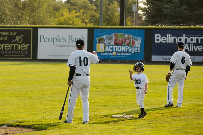Helping the Coach during pre-game practice -- Joe Martin Stadium -- Bellingham, Washington, USA -- Copyright 2013 Jeffrey Friedl, http://regex.info/blog/