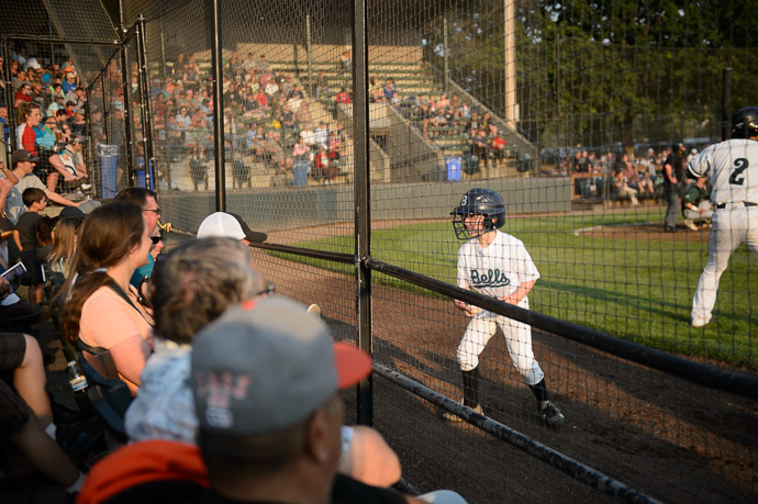 "Saying ""Hi"" to the Family on the way back from picking up a foul ball -- Joe Martin Stadium -- Bellingham, Washington, USA -- Copyright 2013 Jeffrey Friedl, http://regex.info/blog/"