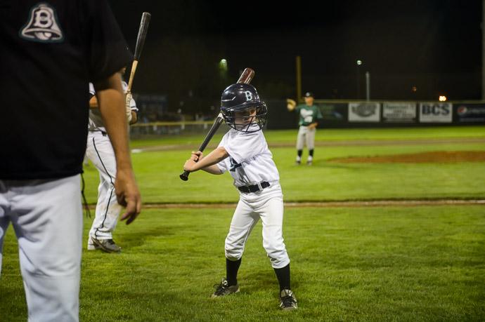 The Stance taking a personal moment on the way back after fetching a bat -- Joe Martin Stadium -- Bellingham, Washington, USA -- Copyright 2013 Jeffrey Friedl, http://regex.info/blog/