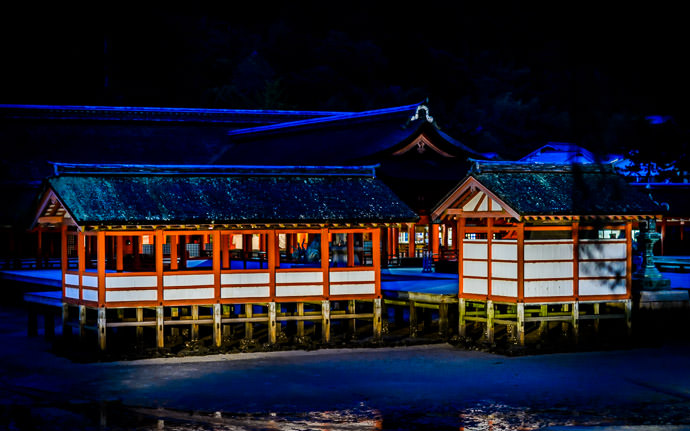 desktop background image of the Itsukushima Shrine (厳島神社) on Miyajima Island, Japan, at dusk, with the roof ridge tiles reflecting the darkening blue sky, creating a newn-glow effect -- Neon -- Itsukushima Shrine (厳島神社) -- Miyajima, Hiroshima, Japan -- Copyright 2013 Jeffrey Friedl, http://regex.info/blog/ -- This photo is licensed to the public under the Creative Commons Attribution-NonCommercial 3.0 Unported License http://creativecommons.org/licenses/by-nc/3.0/ (non-commercial use is freely allowed if proper attribution is given, including a link back to this page on http://regex.info/ when used online)