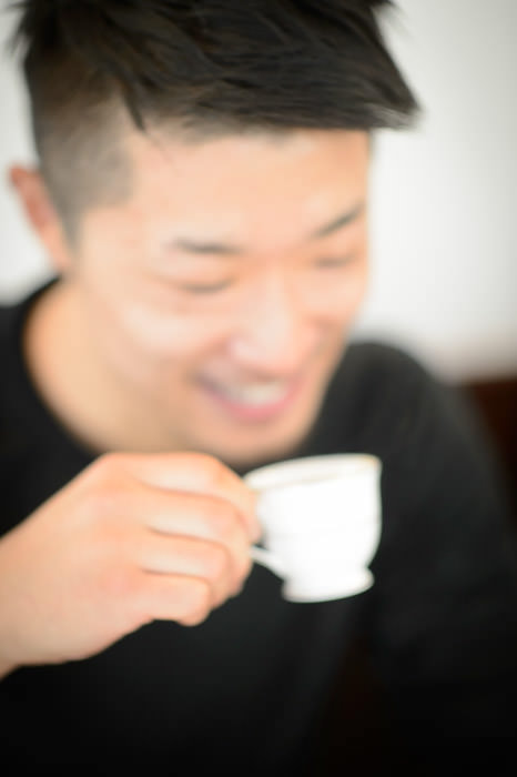 Pure Enjoyment my friend Kataoka-san enjoying his teeny tiny baby-cup of espresso at Restaurant La Verveine , Kyoto Japan -- Copyright 2013 Jeffrey Friedl, http://regex.info/blog/