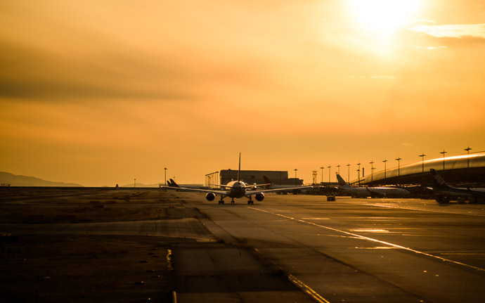 desktop background image of a sundrenched taxiway at Kansai International Airport (関西国際空港) near Osaka Japan -- Right to the Gate Home Sweet Home, arriving last night at the Kansai International Airport (関西国際空港) near Osaka Japan -- Kansai International Airport (関西国際空港) -- Tajiri, Osaka, Japan -- Copyright 2014 Jeffrey Friedl, http://regex.info/blog/ -- This photo is licensed to the public under the Creative Commons Attribution-NonCommercial 4.0 International License http://creativecommons.org/licenses/by-nc/4.0/ (non-commercial use is freely allowed if proper attribution is given, including a link back to this page on http://regex.info/ when used online)