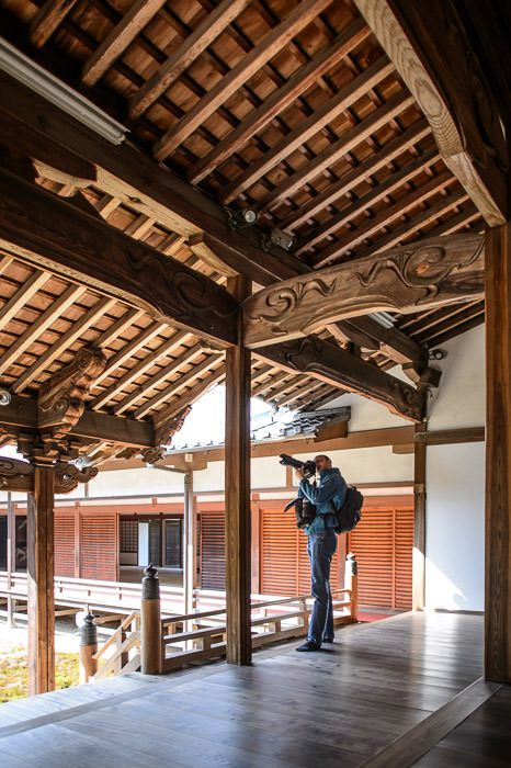 Damien Photographing the Wood Detail -- Zuishin Temple (随心院) -- Kyoto, Japan -- Copyright 2014 Jeffrey Friedl, http://regex.info/blog/ -- This photo is licensed to the public under the Creative Commons Attribution-NonCommercial 4.0 International License http://creativecommons.org/licenses/by-nc/4.0/ (non-commercial use is freely allowed if proper attribution is given, including a link back to this page on http://regex.info/ when used online)