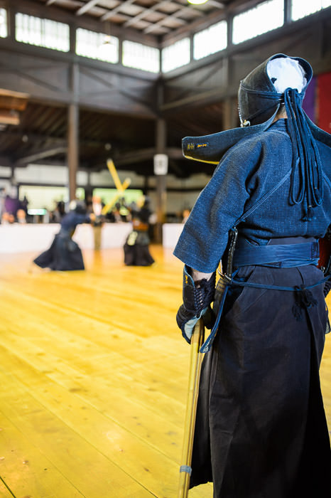 Waiting Kendo master next in line for his match -- 旧武徳殿 -- Kyoto, Japan -- Copyright 2014 Jeffrey Friedl, http://regex.info/blog/ -- This photo is licensed to the public under the Creative Commons Attribution-NonCommercial 4.0 International License http://creativecommons.org/licenses/by-nc/4.0/ (non-commercial use is freely allowed if proper attribution is given, including a link back to this page on http://regex.info/ when used online)