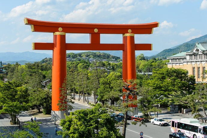 Torii Gate of the Heian Shrine with the Mt. Yoshida hill visible just underneath Kyoto Japan 平安神宮の鳥居と吉田山 -- Rokusisui (六絲水) -- Copyright 2014 Jeffrey Friedl, http://regex.info/blog/