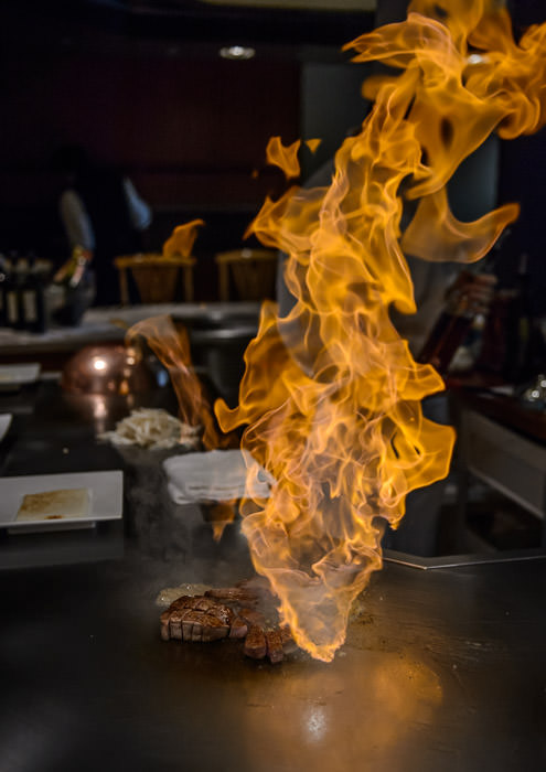Steak on Fire at Himorogi , in the Brighton Hotel Kyoto Japan 京都ブライトンホテルの鉄板焼 -- Restaurant Himorogi, Brighton Hotel (燔、京都ブライトンホテル) -- Copyright 2014 Jeffrey Friedl, http://regex.info/blog/ -- This photo is licensed to the public under the Creative Commons Attribution-NonCommercial 4.0 International License http://creativecommons.org/licenses/by-nc/4.0/ (non-commercial use is freely allowed if proper attribution is given, including a link back to this page on http://regex.info/ when used online)