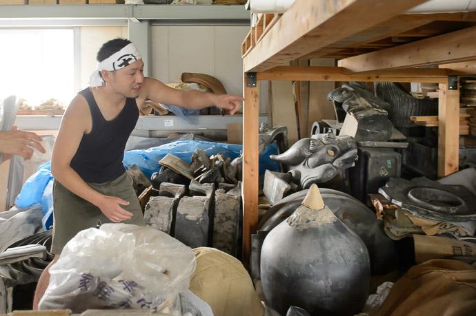 Jumble of Old Pieces that serve as reference for recreations -- Minobe Onigawara Workshop (美濃邉鬼瓦工房) -- Otsu, Shiga, Japan -- Copyright 2014 Jeffrey Friedl, http://regex.info/blog/