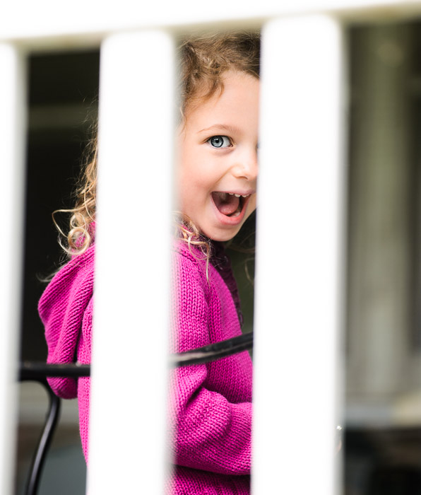 4½-Year-Old Claire caught through a railing -- Grandma and Grandpa's -- Rootstown, Ohio, USA -- Copyright 2014 Jeffrey Friedl, http://regex.info/blog/