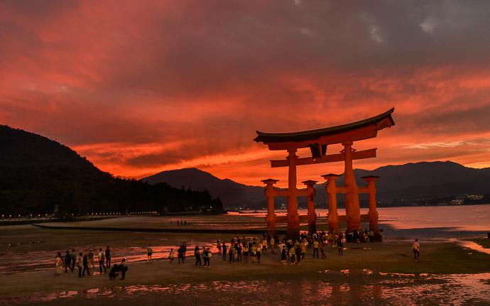 desktop background image of the main gate of the Itsukushima Shrine (厳島神社) at low tide, during sunset the day before a typhoon arrives -- Shrine Gate at Low Tide Itsukushima Shrine (厳島神社) -- Itsukushima Shrine (厳島神社) -- Miyajima, Hiroshima, Japan -- Copyright 2014 Jeffrey Friedl, http://regex.info/blog/ -- This photo is licensed to the public under the Creative Commons Attribution-NonCommercial 4.0 International License http://creativecommons.org/licenses/by-nc/4.0/ (non-commercial use is freely allowed if proper attribution is given, including a link back to this page on http://regex.info/ when used online)