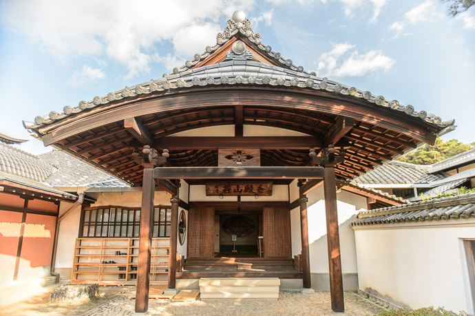 Main Entrance on the right -- Shodensanso Villa (松殿山荘) -- Uji, Kyoto, Japan -- Copyright 2014 Jeffrey Friedl, http://regex.info/blog/ -- This photo is licensed to the public under the Creative Commons Attribution-NonCommercial 4.0 International License http://creativecommons.org/licenses/by-nc/4.0/ (non-commercial use is freely allowed if proper attribution is given, including a link back to this page on http://regex.info/ when used online)