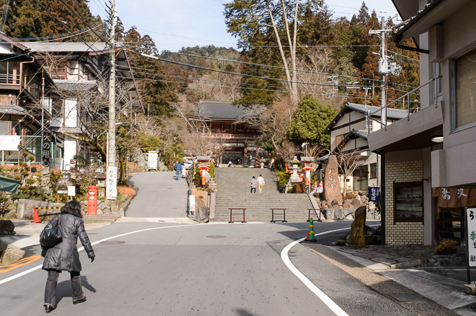 Entrance to the Kurama Temple 鞍馬寺の入り口 10:04am (16.1km), taken one-handed while riding at 14 km/h I thought I saw a deer as I went by, but it could have been a monkey -- Kyoto, Japan -- Copyright 2015 Jeffrey Friedl, http://regex.info/blog/ -- This photo is licensed to the public under the Creative Commons Attribution-NonCommercial 4.0 International License http://creativecommons.org/licenses/by-nc/4.0/ (non-commercial use is freely allowed if proper attribution is given, including a link back to this page on http://regex.info/ when used online)