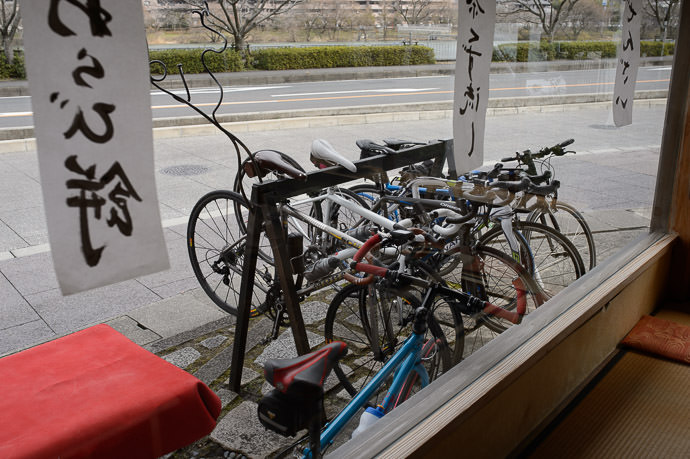 Bicycle Parking most cyclists forego a kickstand to reduce weight -- Sajo-Toson (茶丈藤村) -- Kyoto, Japan -- Copyright 2015 Jeffrey Friedl, http://regex.info/blog/