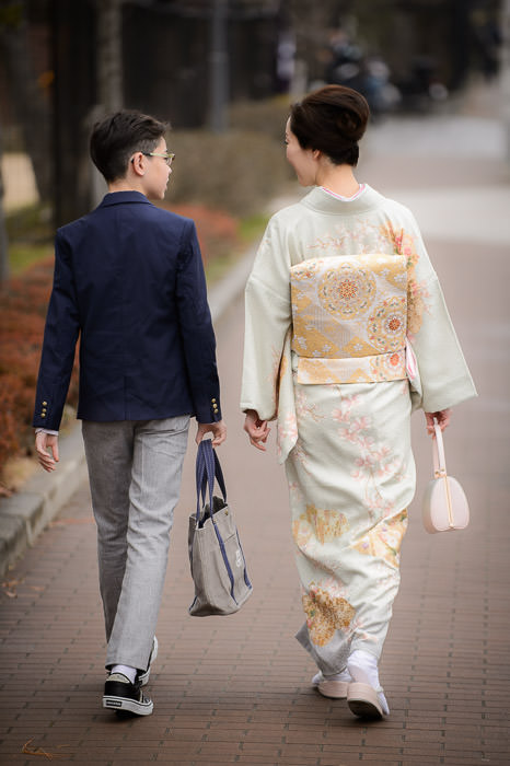 Heading To Graduation a young man and his mother -- Kyoto, Japan -- Copyright 2015 Jeffrey Friedl, http://regex.info/blog/