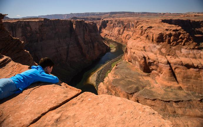 desktop background image of Anthony overlooking Horseshoe Bend in Page Arizona -- Thinking Big -- Page, Arizona, United States -- Copyright 2015 Jeffrey Friedl, http://regex.info/blog/