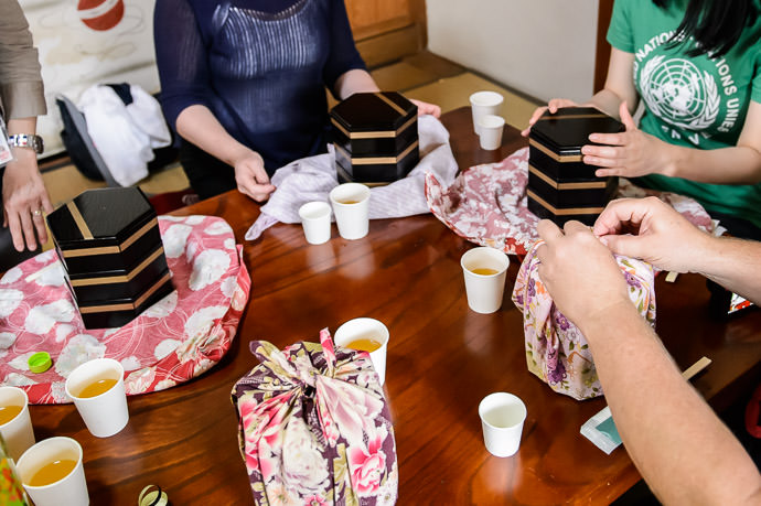 Unwrapping Our Lunches -- Otsu, Shiga, Japan -- Copyright 2015 Jeffrey Friedl, http://regex.info/blog/