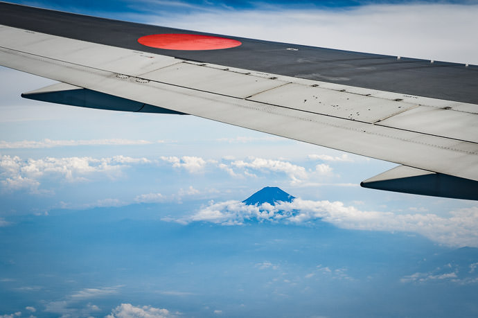 Mt. Fuji under the rising sun 富士山 from 77km away and 5½km above (48 miles away and 3½ miles above) -- Japan -- Copyright 2016 Jeffrey Friedl, http://regex.info/blog/ -- This photo is licensed to the public under the Creative Commons Attribution-NonCommercial 4.0 International License http://creativecommons.org/licenses/by-nc/4.0/ (non-commercial use is freely allowed if proper attribution is given, including a link back to this page on http://regex.info/ when used online)