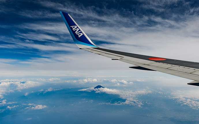 desktop background image of Mt. Fuji from an ANA flight 50 miles away -- Smart Marketing Airline name on the inside of the winglet puts the name in all the out-the-window photos -- Kamo District -- Matsuzaki-cho, Shizuoka, Japan -- Copyright 2016 Jeffrey Friedl, http://regex.info/blog/ -- This photo is licensed to the public under the Creative Commons Attribution-NonCommercial 4.0 International License http://creativecommons.org/licenses/by-nc/4.0/ (non-commercial use is freely allowed if proper attribution is given, including a link back to this page on http://regex.info/ when used online)