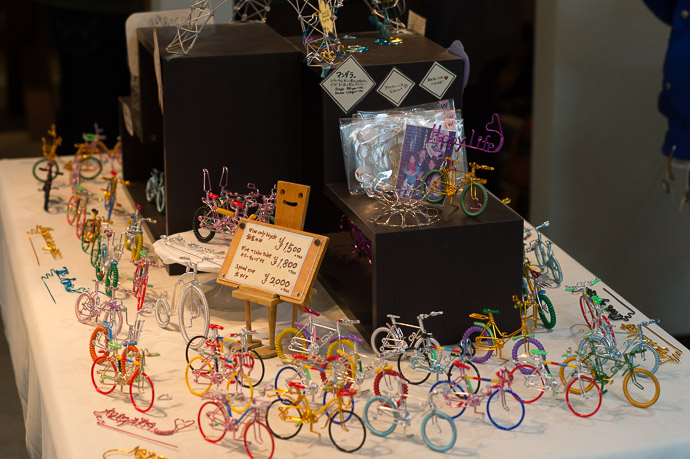 Lots of Tiny Bicycles -- Happy Bicycle -- Kyoto, Japan -- Copyright 2017 Jeffrey Friedl, http://regex.info/blog/ -- This photo is licensed to the public under the Creative Commons Attribution-NonCommercial 4.0 International License http://creativecommons.org/licenses/by-nc/4.0/ (non-commercial use is freely allowed if proper attribution is given, including a link back to this page on http://regex.info/ when used online)
