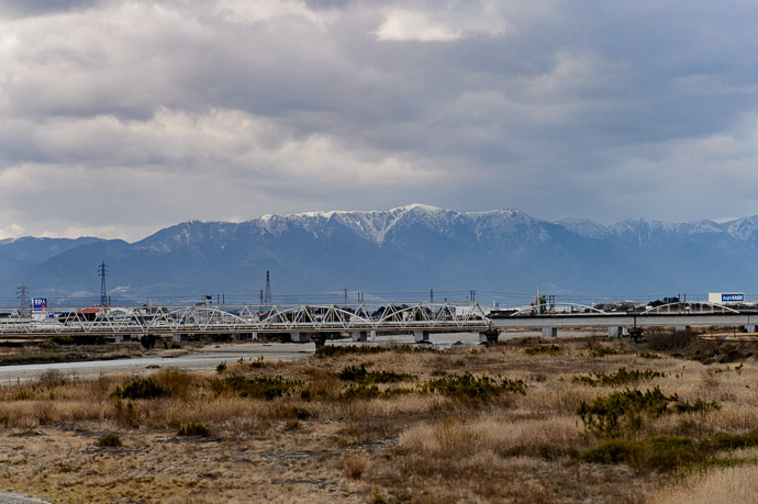 Snowy Mountains of Shiga from the window of the bullet train -- Yasu, Shiga, Japan -- Copyright 2017 Jeffrey Friedl, http://regex.info/blog/