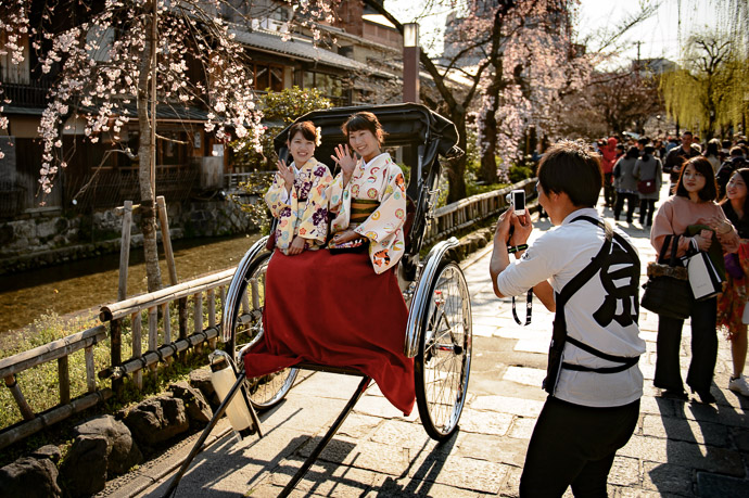 Obnoxiously Rude In pointing the camera at these ladies, I took their attention from their ricksha-driver photographer. -- Kyoto, Japan -- Copyright 2017 Jeffrey Friedl, http://regex.info/blog/ -- This photo is licensed to the public under the Creative Commons Attribution-NonCommercial 4.0 International License http://creativecommons.org/licenses/by-nc/4.0/ (non-commercial use is freely allowed if proper attribution is given, including a link back to this page on http://regex.info/ when used online)