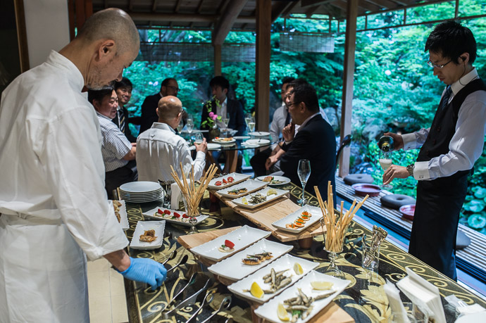 Setting Out the Hors d'Oeuvres Chef Koji Ueshima at AIC Akitsushima Kyoto -- AIC秋津洲京都 -- Kyoto, Japan -- Copyright 2017 Jeffrey Friedl