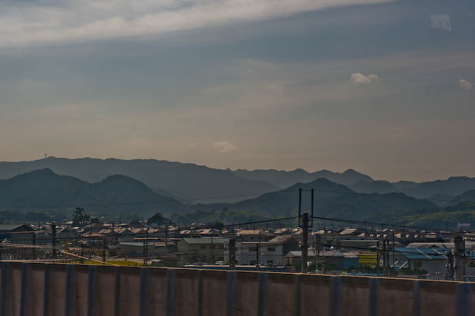 Typical Hot/muggy/hazy view from the train -- Kansai International Airport, Osaka, Japan -- Copyright 2008 Jeffrey Eric Francis Friedl, http://regex.info/blog/