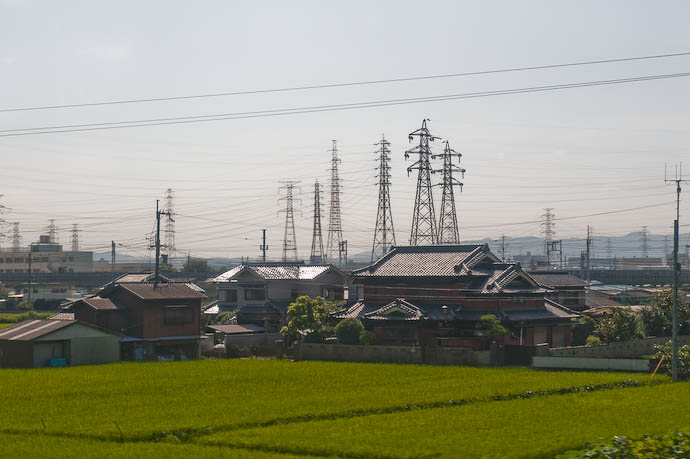 Atypical shot from the train showing area with a lot of power lines -- Kansai International Airport, Osaka, Japan -- Copyright 2008 Jeffrey Eric Francis Friedl, http://regex.info/blog/