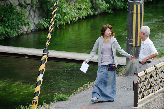 """Would You Mind Going Around?"" herding random passers-by out of frame -- Kyoto, Japan -- Copyright 2008 Jeffrey Eric Francis Friedl"