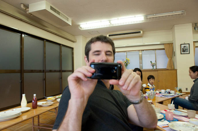 Anthony's Picture of Daddy using his iPhone to take a picture of Anthony wielding a D700 + big 24-70/2.8 lens  --  Kyoto, Japan  --  Copyright 2008 Jeffrey Friedl, http://regex.info/blog/