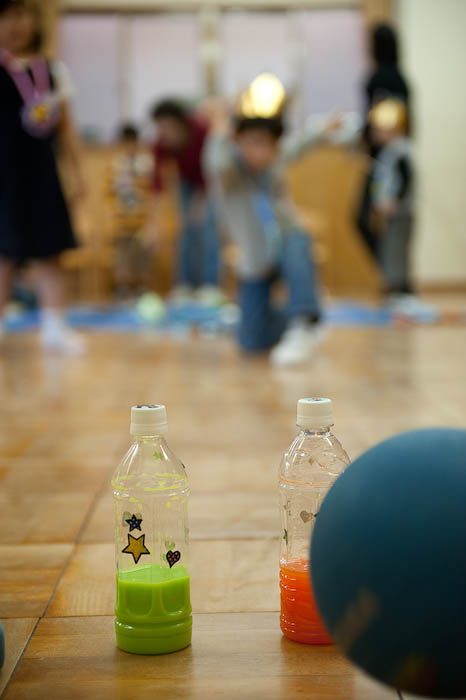 Not Sure how he managed to get the ball behind the bottles he was attempting to bowl down  --  Kyoto, Japan  --  Copyright 2008 Jeffrey Friedl, http://regex.info/blog/