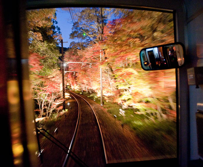 ", f/2.8, ISO 6400 — map & image data — nearby photos Eizan Train Line's ""Fall Foliage Tunnel"" Evening Lightup Kyoto, Japan -- Copyright 2008 Jeffrey Friedl, http://regex.info/blog/"