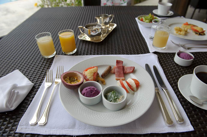 Breakfast is (Self) Served at the Atta Terrace Hotel, Okinawa Japan, January 2009 Just getting started with passion fruit, sweet potato, some local bitter greens, and more... -- Copyright 2009 Jeffrey Friedl, http://regex.info/blog/