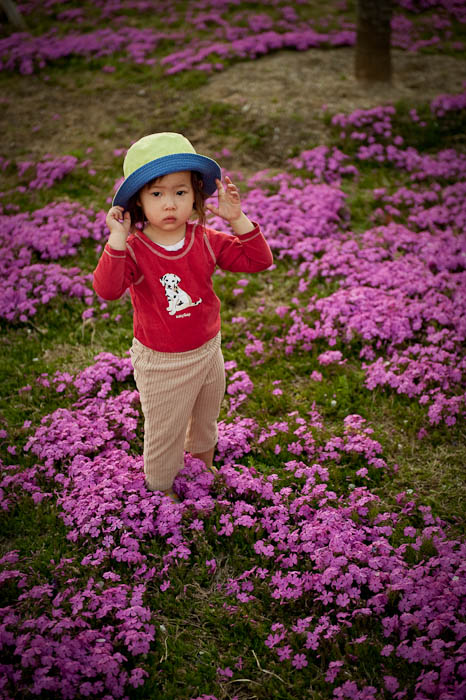 "22-month-old Zoe Tamaki Braverman She's Got the ""Pouty-Cute"" Thing Down Pat -- Ojigaoka Park -- Otsu, Shiga, Japan -- Copyright 2009 Jeffrey Friedl, http://regex.info/blog/"
