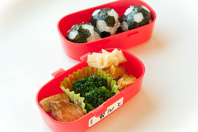 Today's Bento soccer-ball onigiri , salmon, broccoli, potato korokke and a bonus snack of raw yatsuhashi -- Kyoto, Japan -- Copyright 2009 Jeffrey Friedl, http://regex.info/blog/