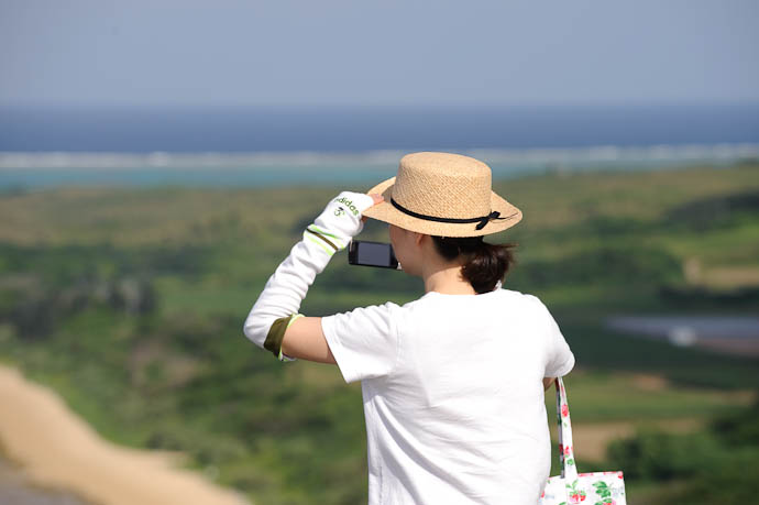 Taking Some Shots Herself -- Ishigaki, Okinawa, Japan -- Copyright 2009 Jeffrey Friedl, http://regex.info/blog/