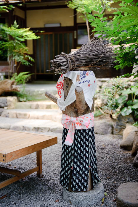 Lady Carrying a Bundle of Sticks? (if it were a real person, would babies be on her head?) -- Sanzen-in Temple -- Kyoto, Japan -- Copyright 2009 Jeffrey Friedl, http://regex.info/blog/