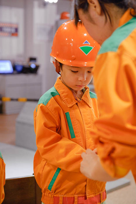 Minor Uniform Adjustment ( I just love his face in this one ) -- KidZania Koshien -- Kyoto, Japan -- Copyright 2009 Jeffrey Friedl, http://regex.info/blog/