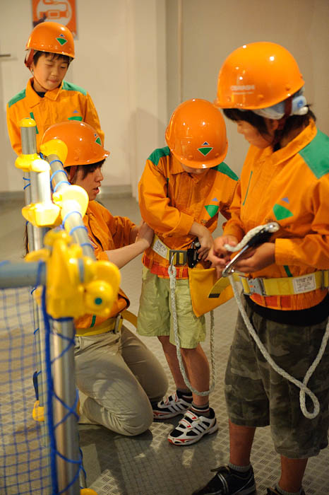 Putting Safety Equipment Away -- KidZania Koshien -- Kyoto, Japan -- Copyright 2009 Jeffrey Friedl, http://regex.info/blog/