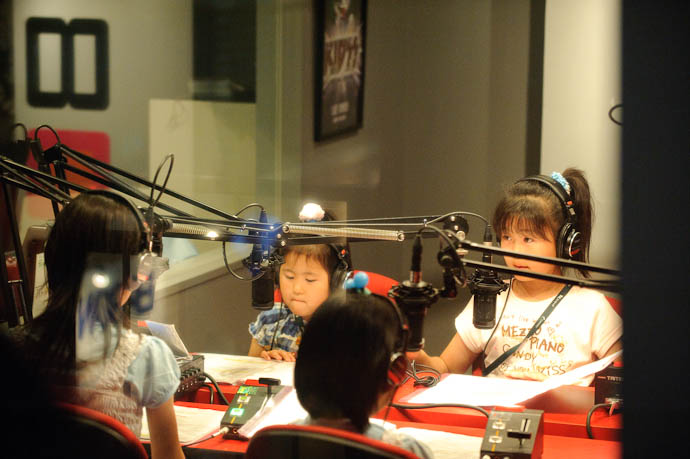 Radio Broadcast the kids get to use the most-excellent Sony MDR-V6 headphones -- KidZania Koshien -- Kyoto, Japan -- Copyright 2009 Jeffrey Friedl, http://regex.info/blog/