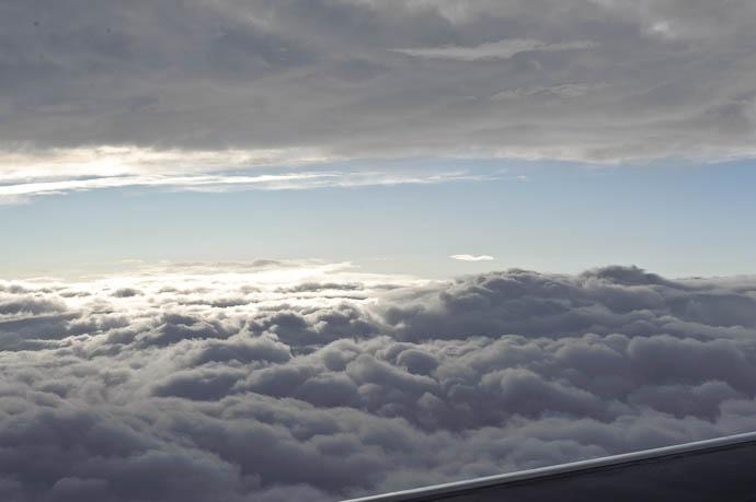 Sandwiched between cloud layers at 20,000 feet 15 minutes out of Tokyo Narita, heading toward Osaka -- Flight from Tokyo Narita to Osaka Itami -- Ichihara, Chiba, Japan -- Copyright 2009 Jeffrey Friedl, http://regex.info/blog/