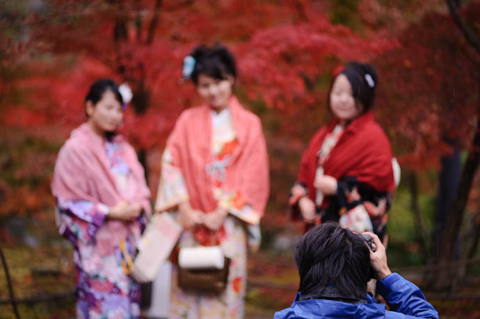"""Dolled Up I had no interest in photographing these """"less classy"""" dolled up girls, but got the shot of someone who did -- Eikando Temple -- Kyoto, Japan -- Copyright 2009 Jeffrey Friedl, http://regex.info/blog/"""